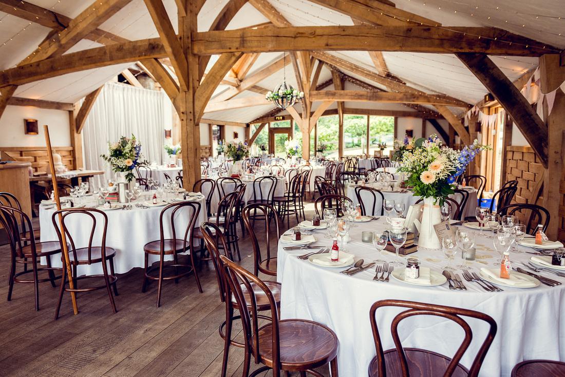 room set up for wedding breakfast at Cripps Barn