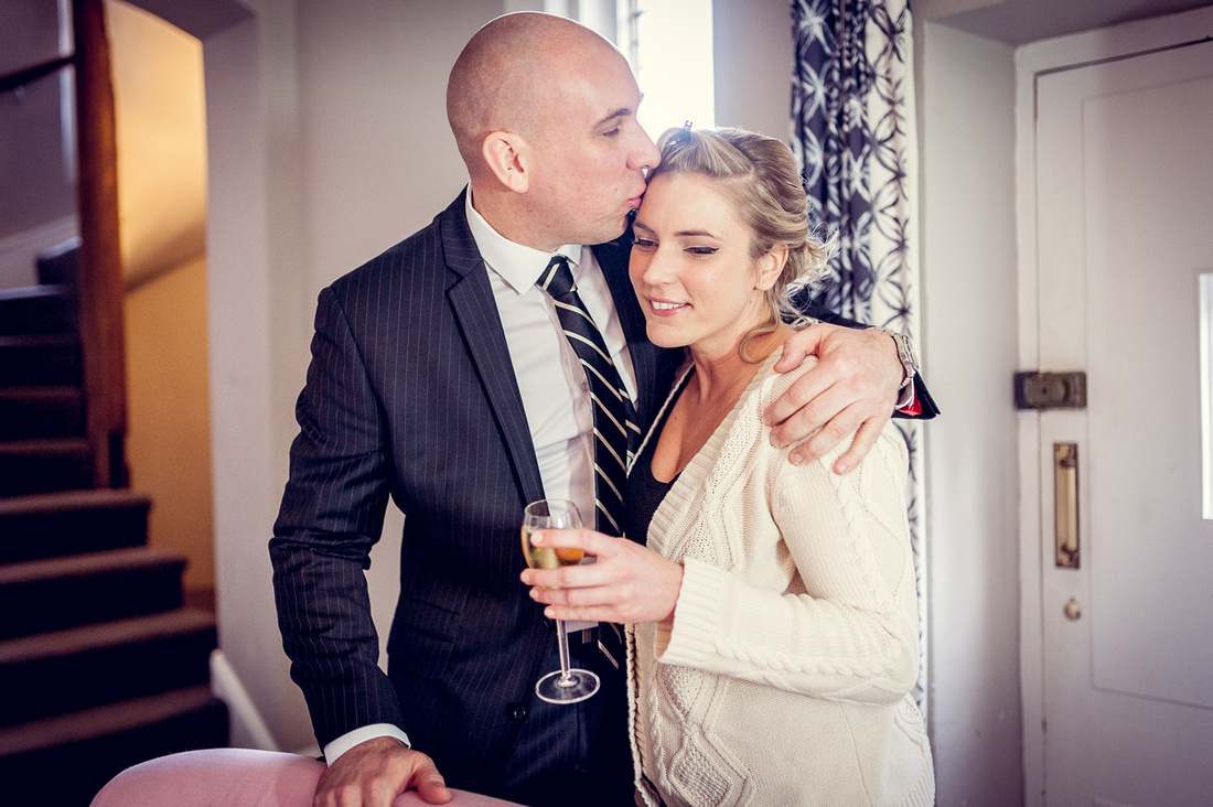 wedding photography at hampton manor bride hugging brother holding champagne butler's lodge