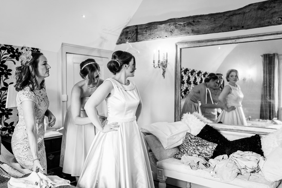 vintage style bride looks in a mirror