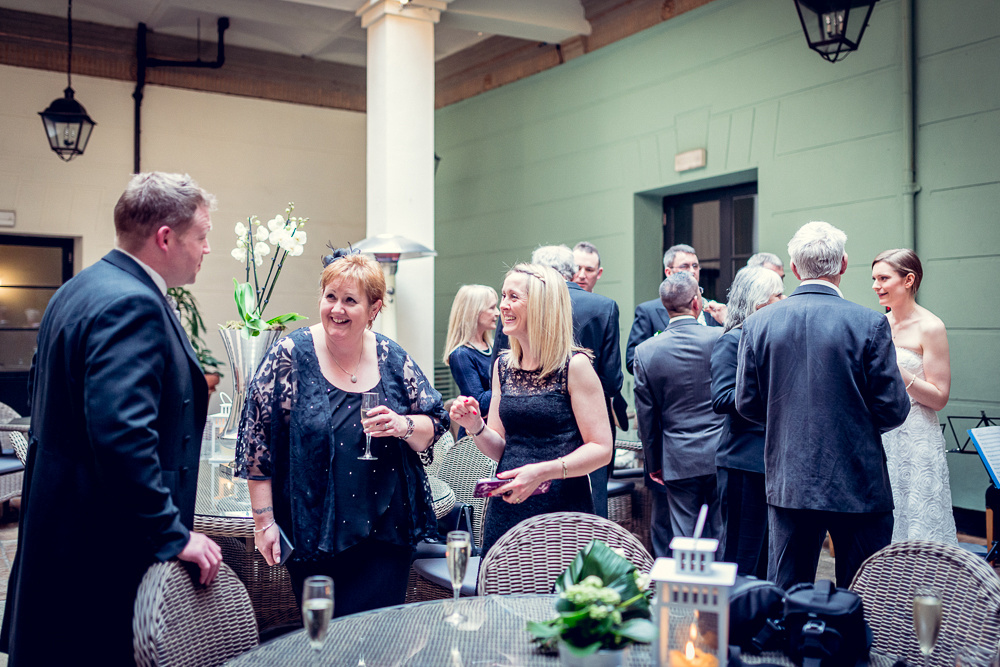 guests laughing at wedding reception at Hotel du Vin