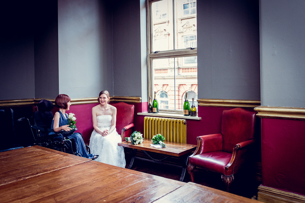 bride chatting to bridesmaid before wedding at Hotel du Vin in Birmingham