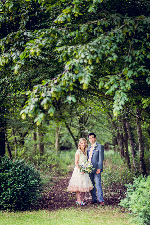 relaxed bride and groom portrait at Cripps Barn wedding