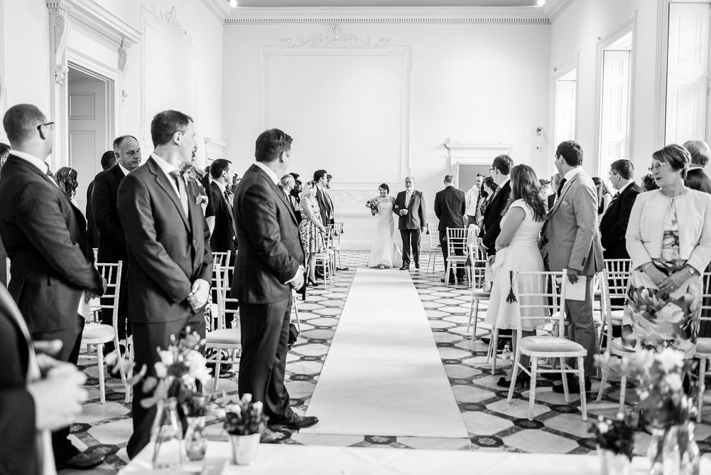 bride walks down the aisle with father at Compton Verney wedding