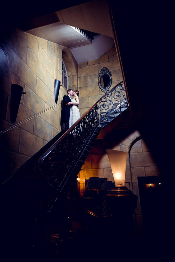 bride and groom kiss on staircase at Hotel du Vin in Birmingham