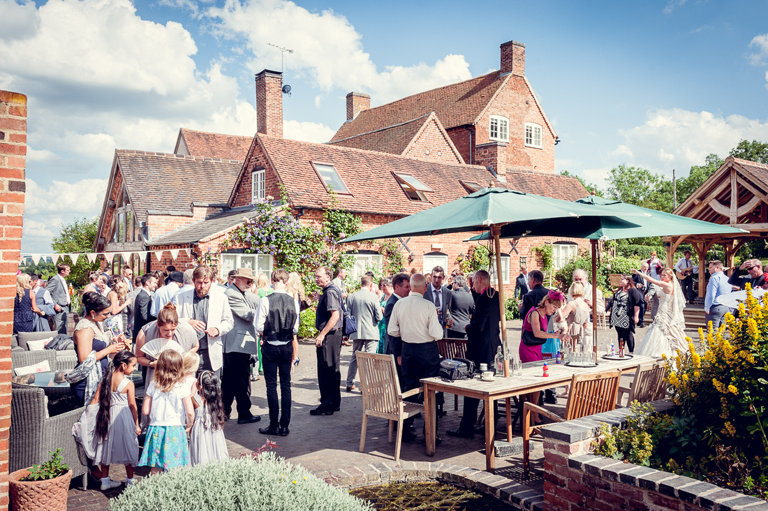 Wedding Photography at Wethele Manor in Warwickshire summer outdoor ceremony relaxed creative female photographer