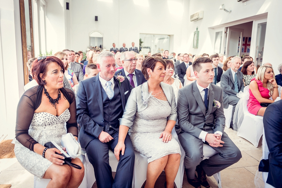 groom's family look on at Fazeley Studios wedding