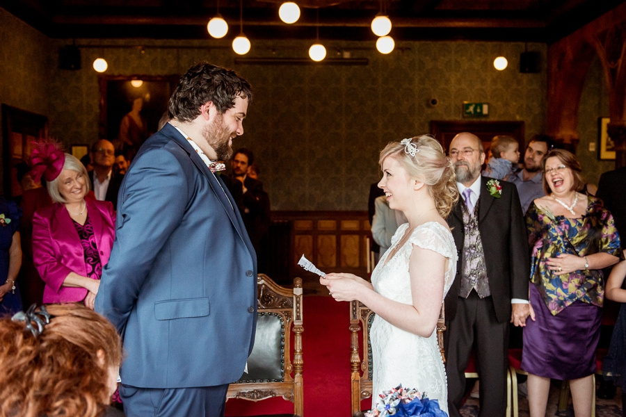 Wedding photography at Highbury Hall in Birmingham bride and groom saying vows