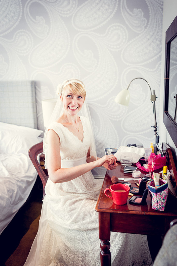 bride getting ready in lace Minna wedding dress