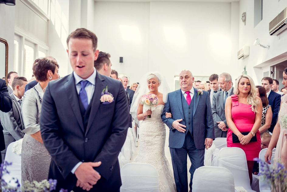 emotional bride walking down the aisle at Fazeley Studios in Birmingham