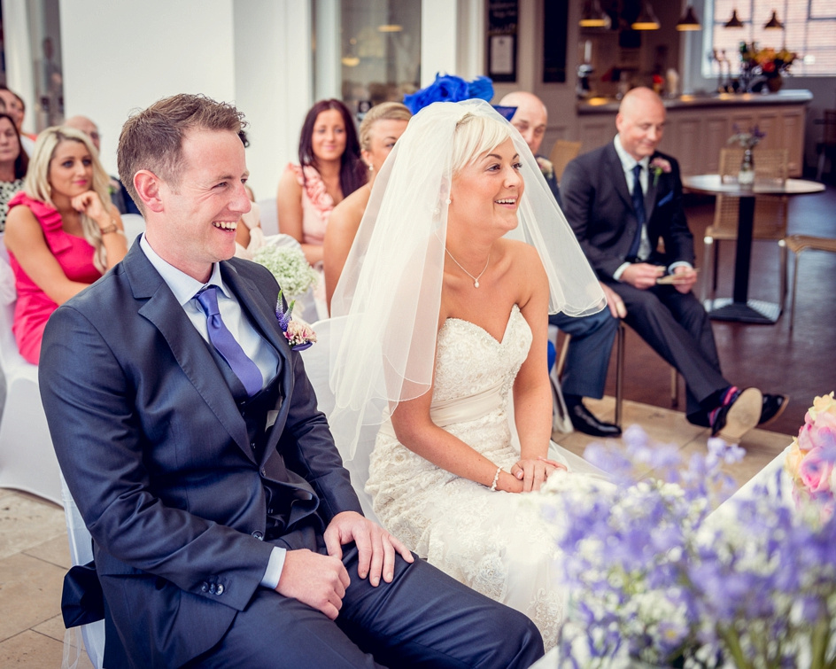 bride and groom smiling during ceremony at Fazeley Studios in Birmingham