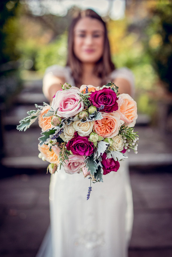 bride with bouquet of peach and pink roses