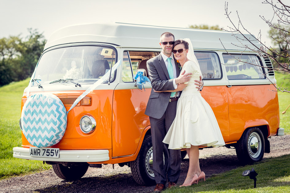 bride and groom in sunglasses with orange vintage VW Camper Van