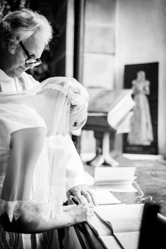 bride signing the register at St Mary's Church Hatton Warwickshire