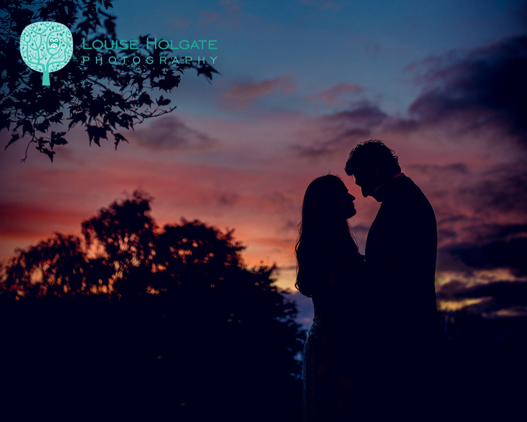 Bride and groom sunset silhouette at Hampton Manor wedding