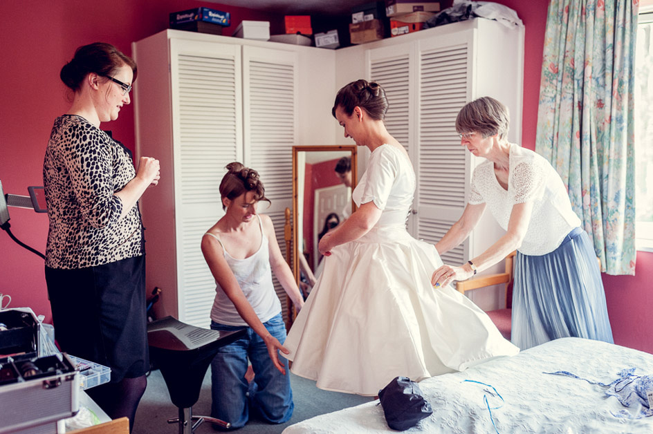 bride putting on vintage style short dress