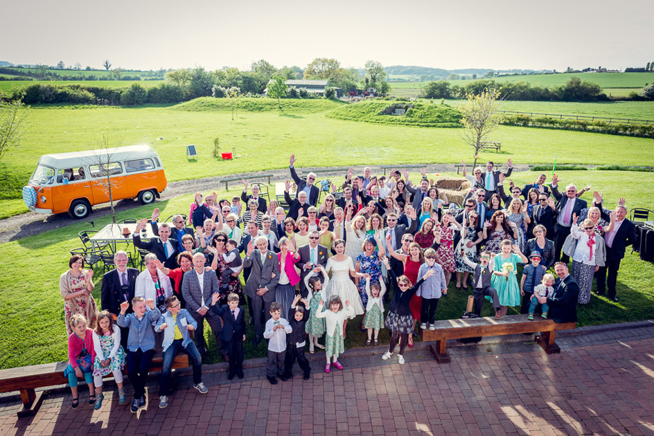 group shot at Wootton Park wedding with vintage VW camper van