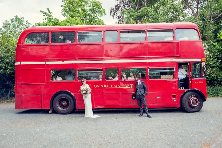 bride and groom in front of Routemaster bus with silly bridesmaid
