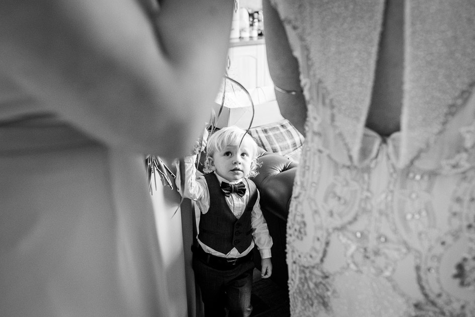 Page  boy looks at bride and bridesmaids