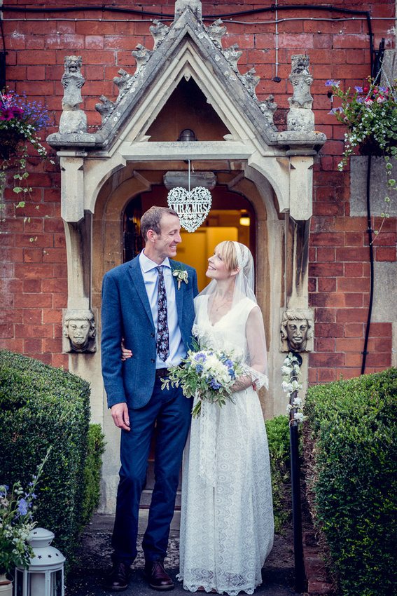 bride and groom outside Hatton Village Hall in Warwickshire
