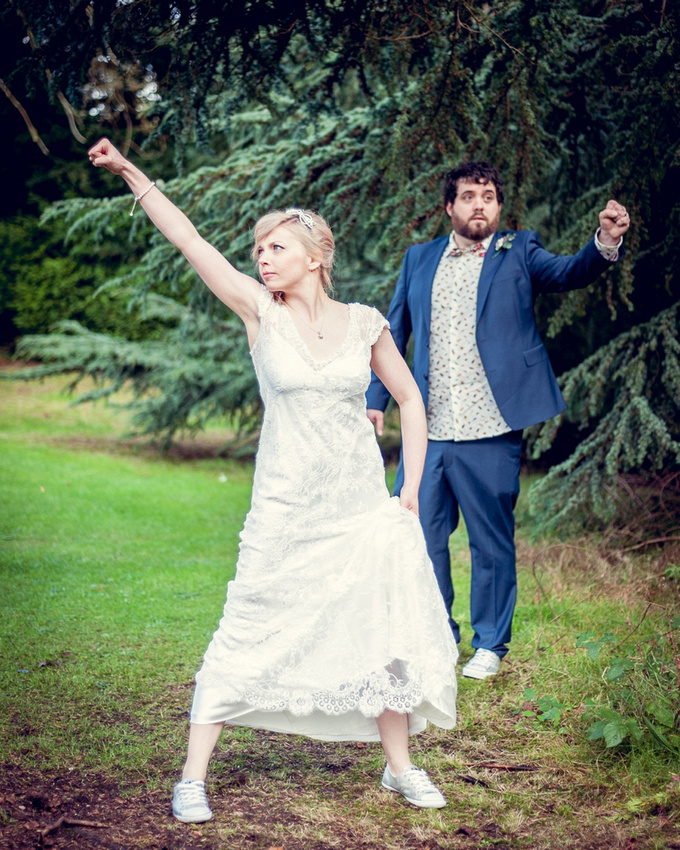 Wedding photography at Highbury Hall in Birmingham bride and groom superhero pose