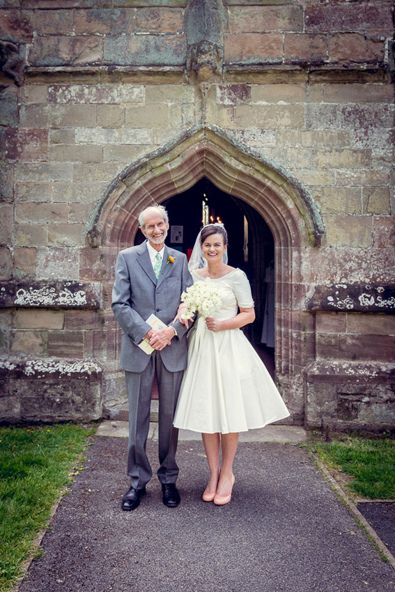 bride with father outside Inkberrow Church