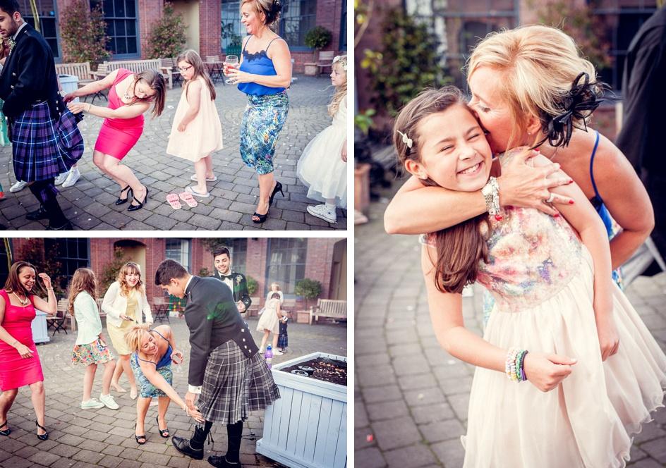 wedding guests look under kilts