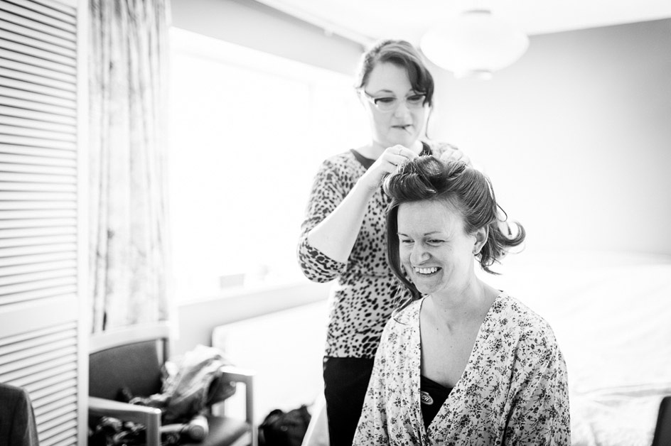 bride having hair done in a vintage style