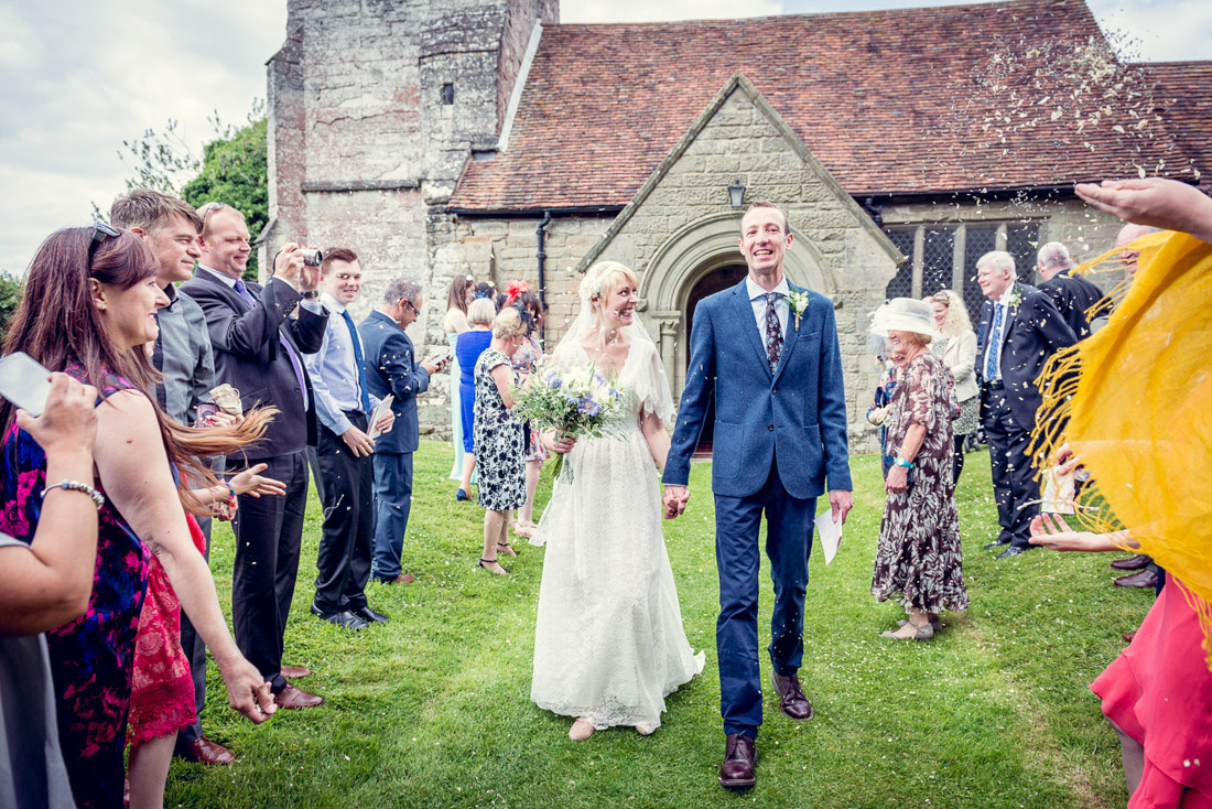 guests throw confetti outside St Mary's Church Hatton Warwickshire