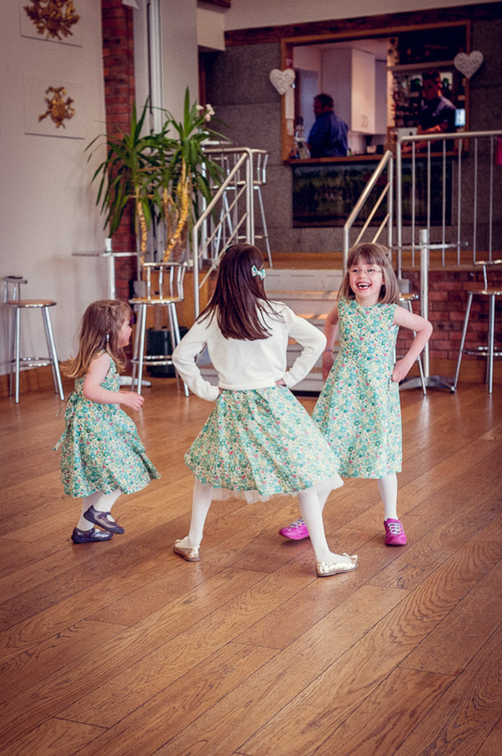 cute bridesmaids dancing in Liberty print dresses