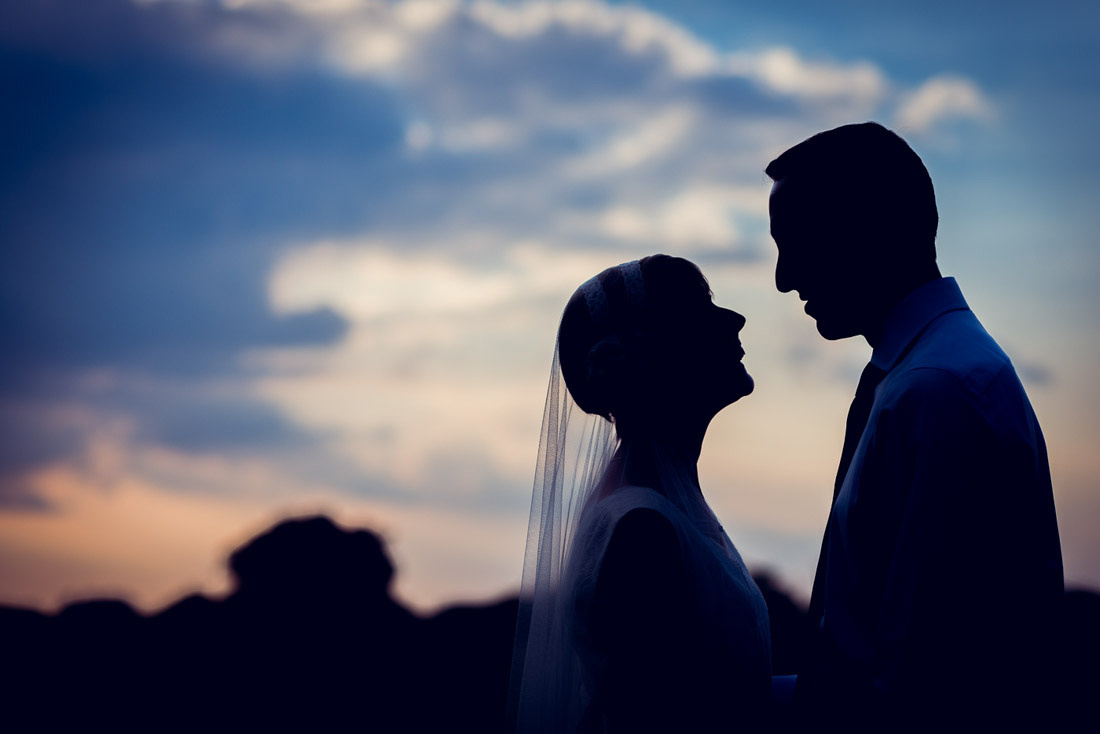 bride and groom sunset silhouette at Hatton Village Hall on midsummer's day