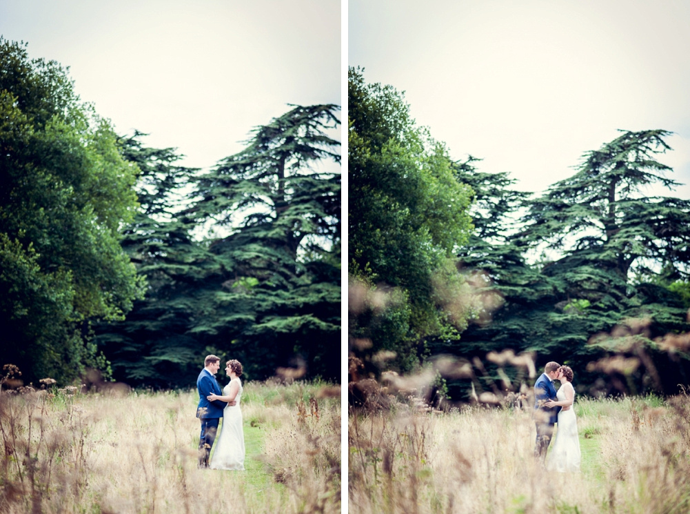 romantic portrait in long grass at Warwickshire wedding