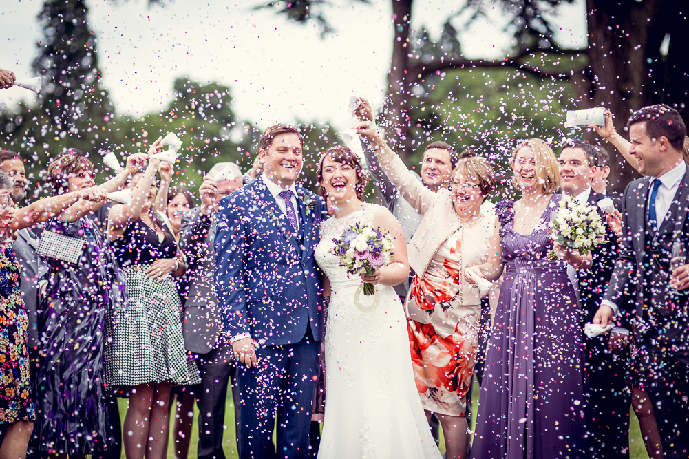 guests throwing confetti at Compton Verney wedding