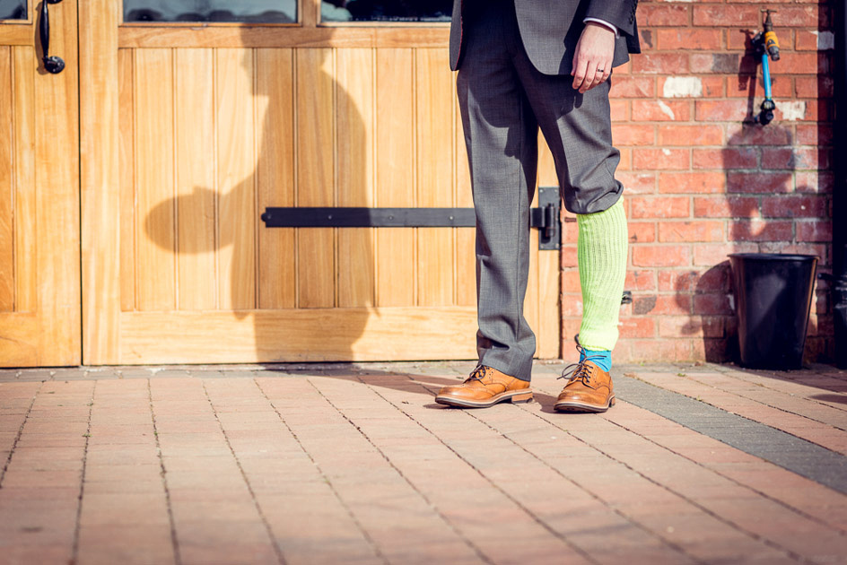 groom wearing lime green legwarmer during best man's speech
