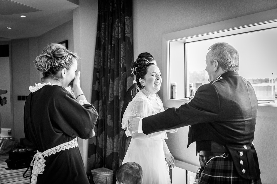emotional bride when dad sees her in her wedding dress