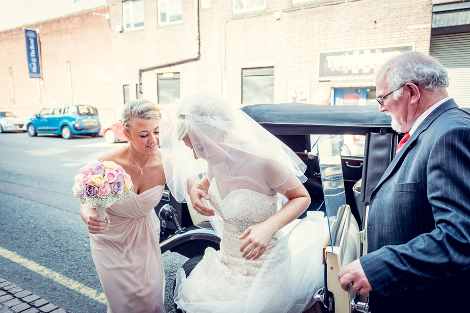 bride getting out of vintage car at Fazeley Studios in Birmingham