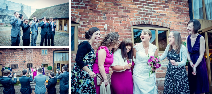 Wedding Photography at Curradine Barns in Worcestershire bride laughing with friends