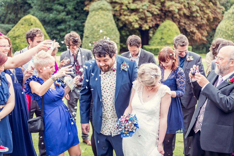 Wedding photography at Highbury Hall in Birmingham throwing confetti close up